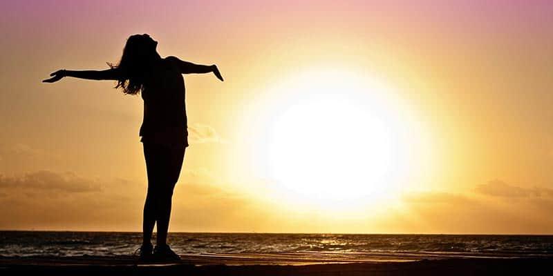 Girl Standing on Beach Sunset