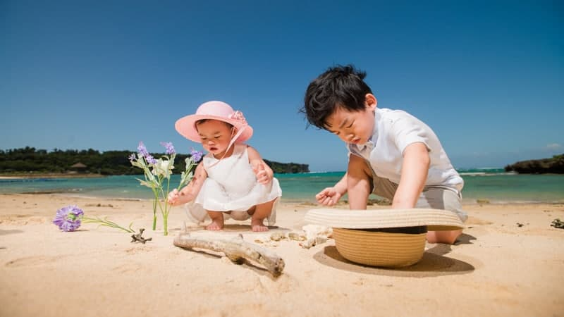 Baby and toddler playing on beach - Most Baby and Toddler Friendly Cruises