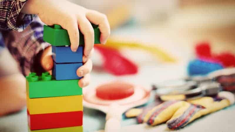 Child playing with building blocks - Most Baby and Toddler Friendly Cruises