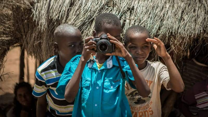 African boys with camera