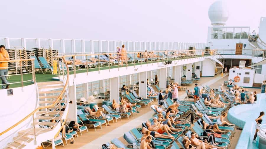 Swimming pool and lounges on cruise ship