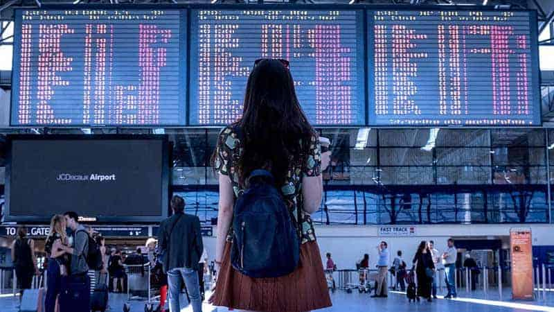 woman standing in airport.