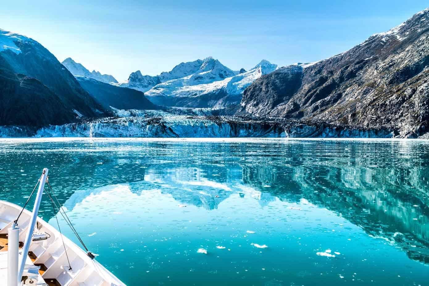 Cruise ship cruising towards glacier in Alaska.