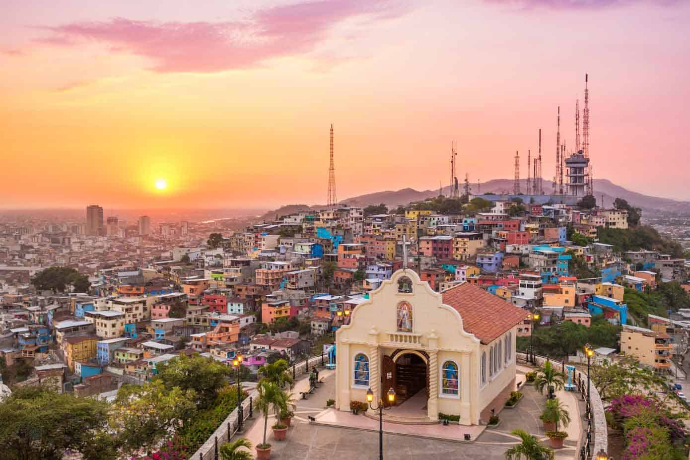 Sunset over hills and sprawling city in Guayquil, Ecuador.