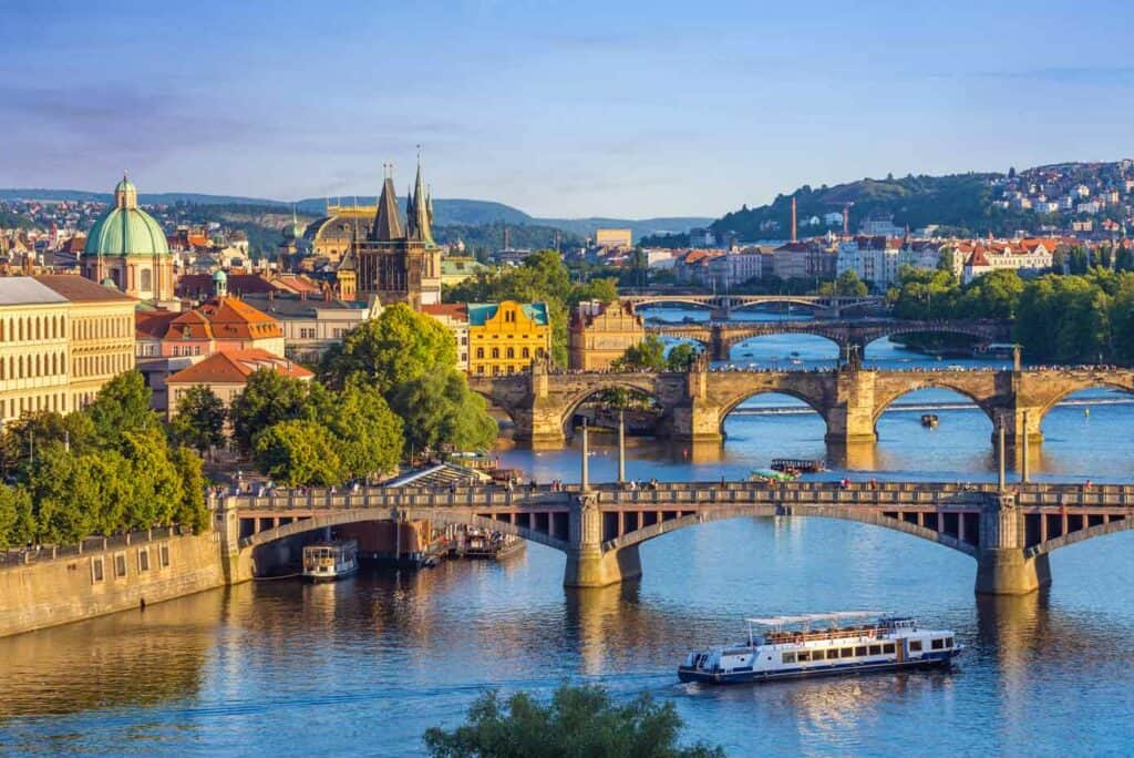 Picturesque skyline and Charles Bridge over a river in Prague, Czech Republic.