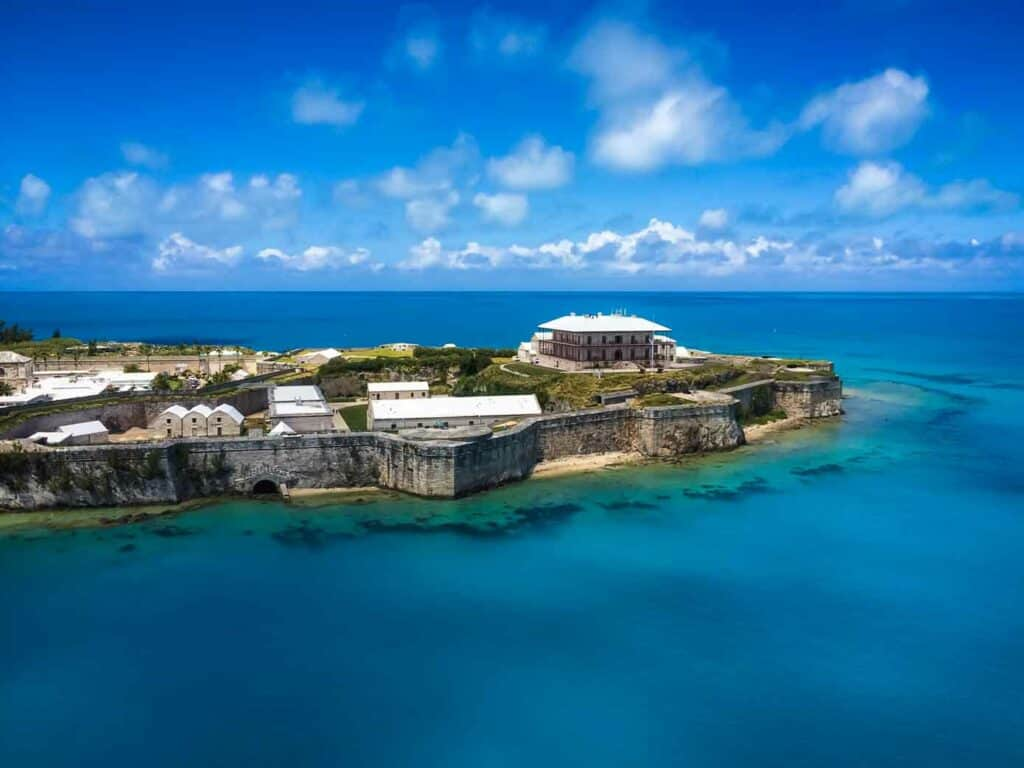 Old fortress called Royal Naval Dockyard in Bermuda jetting into a beautiful blue ocean.