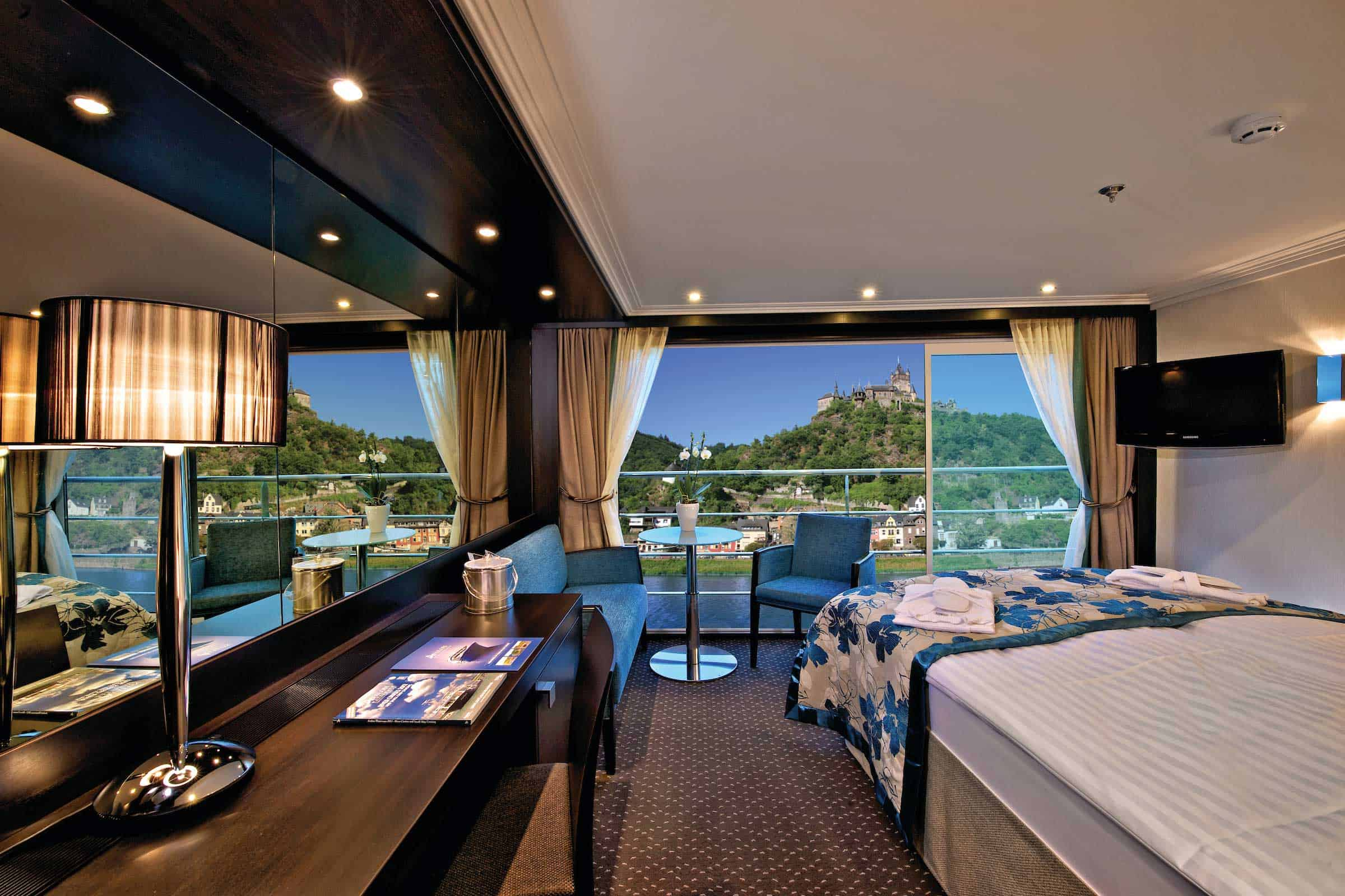 Luxurious cruise ship cabin with balcony.