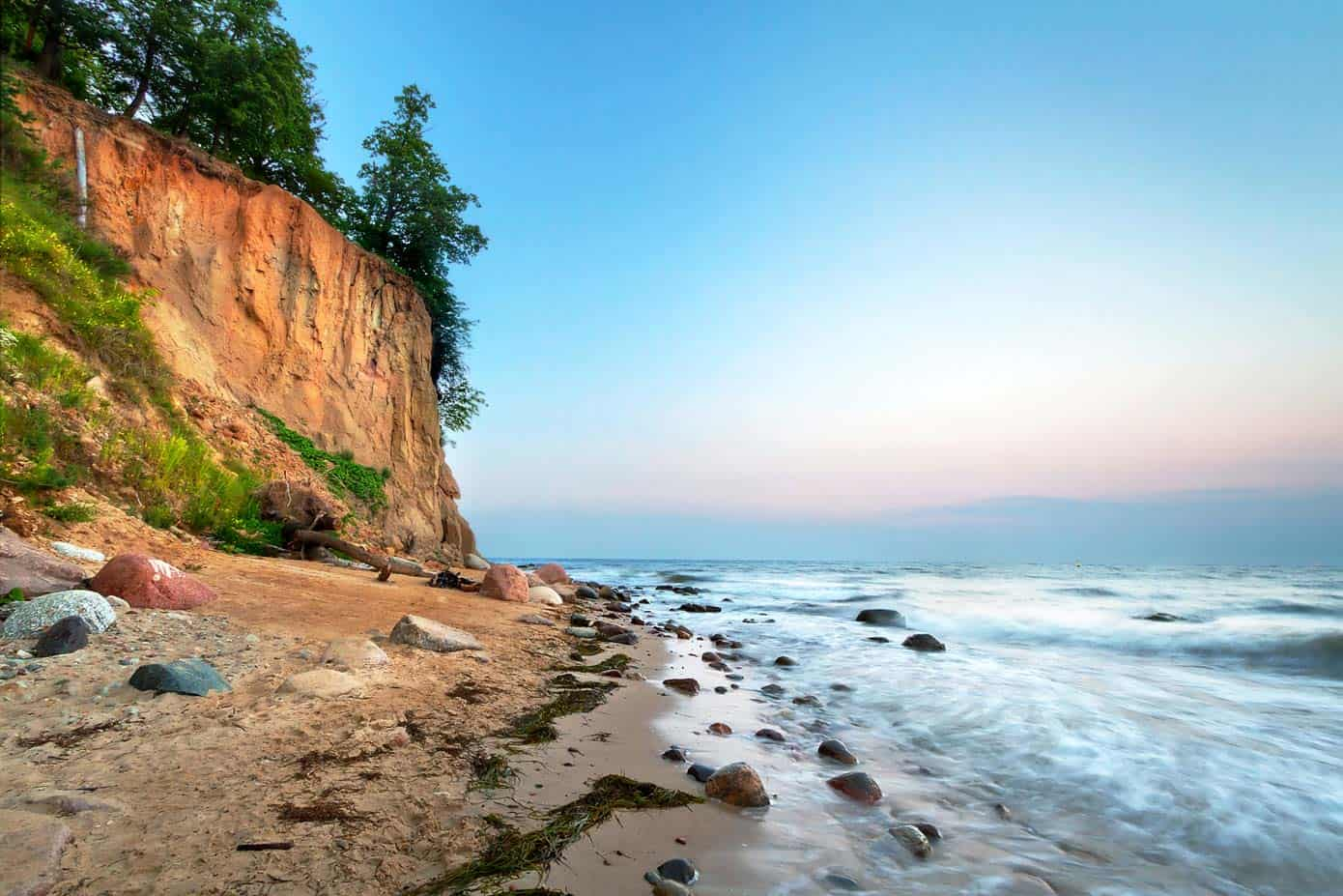 Massive cliffs leading into the ocean in Poland, Europe.