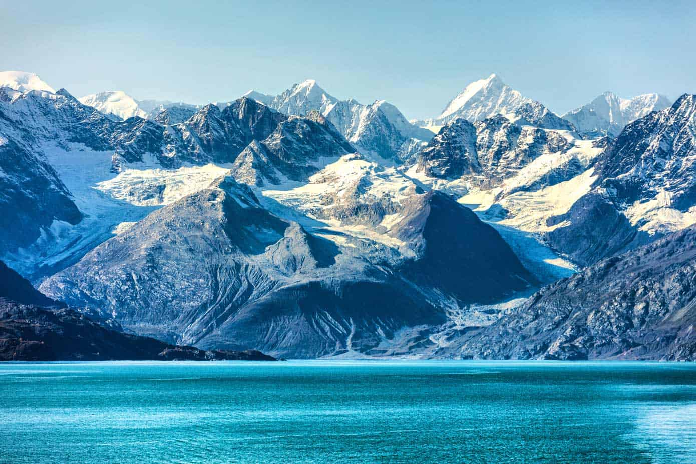 Mountains overlooking picturesque Glacier Bay National Park on an Alaska cruise.
