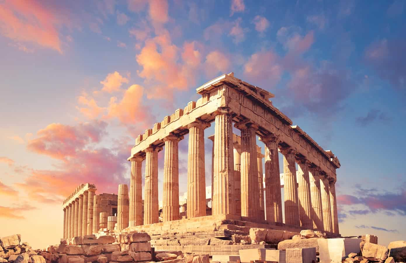 Ancient Parthenon on the Acropolis in Athens, Greece at sunset.
