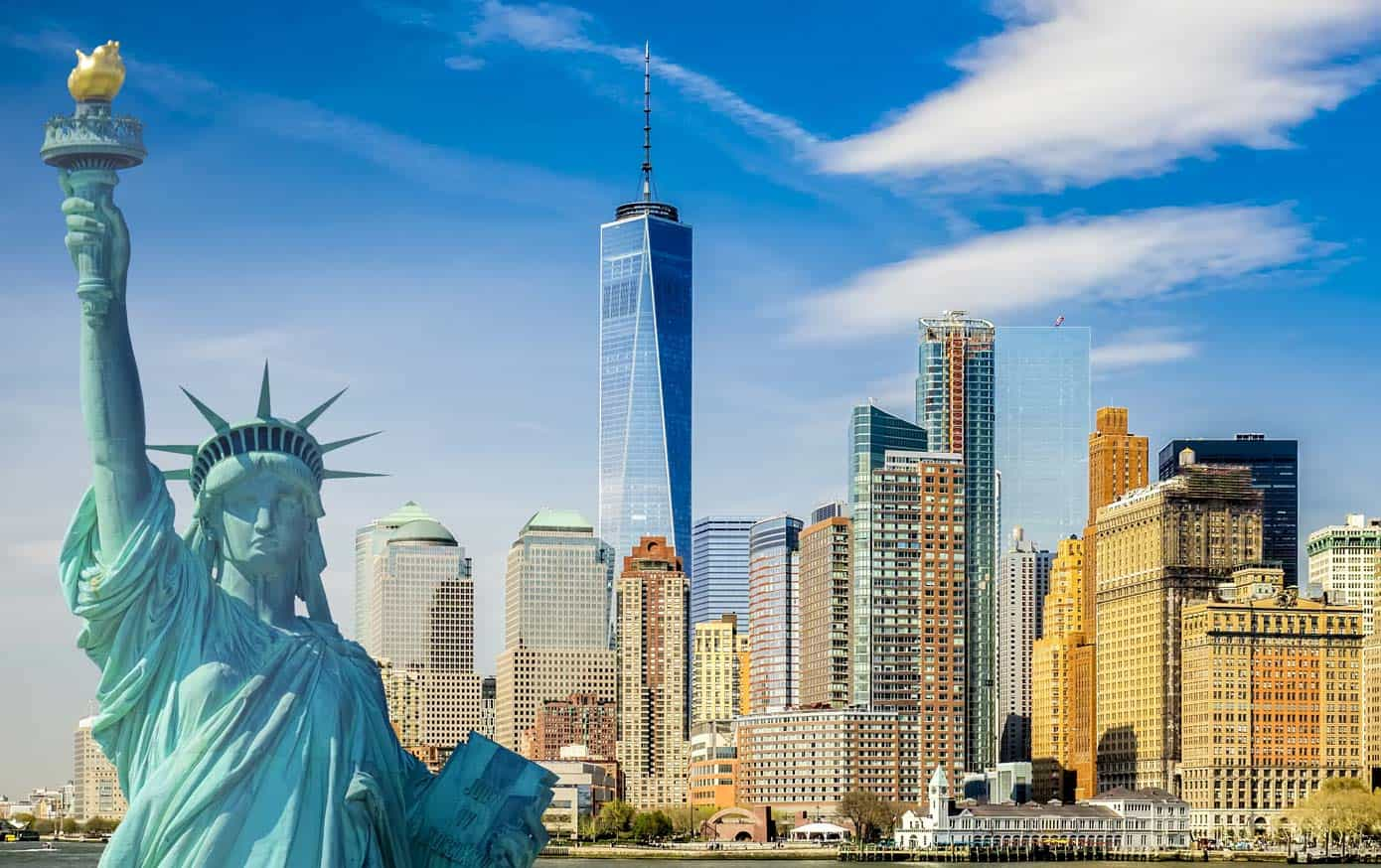The New York City skyline with the Statue of Liberty in front of the World Trade Center.